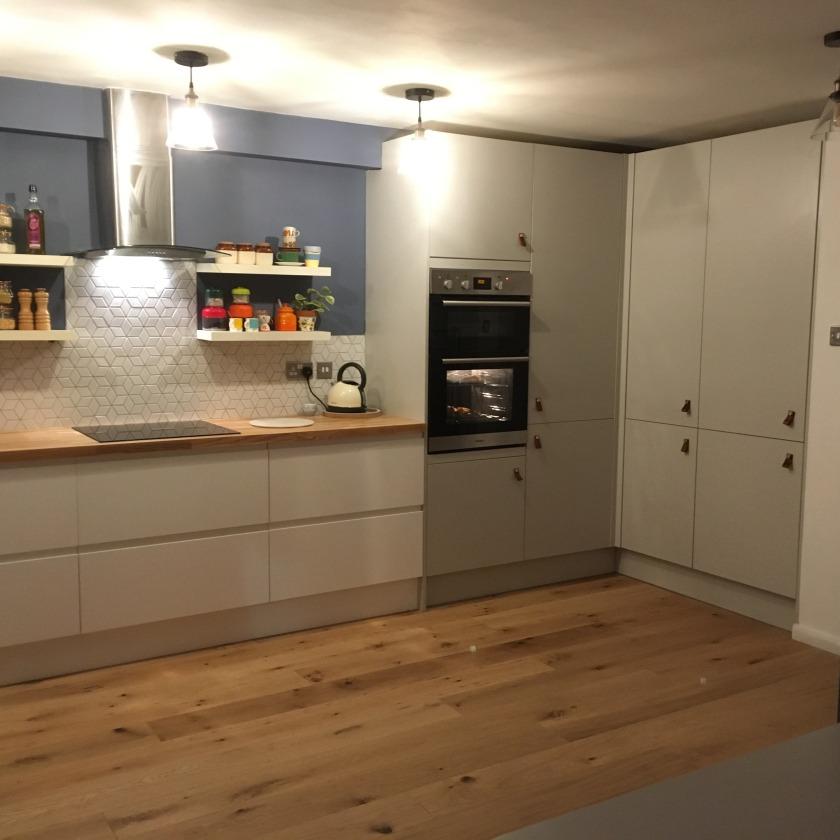 Nesting Properties_leather pulls seamless kitchen cupboard doors