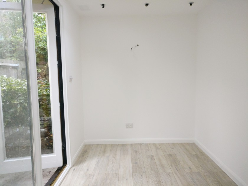 Garden Studio Interior_white walls_white oak laminate flooring_garden room design and build